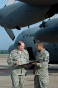SMSgt. David Dunn (left) and MSgt. Abel Alverez (right), both the from the 19th Aircraft Maintenance Squadron's Green Dragon flight, review the maintenance log for 61-2358 prior to the aircraft's retirement ceremony and final flight on 1 May 2012.