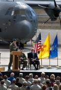US Air Force Maj. Gen. Mark Solo, commander of 19th Air Force, speaks before the assembled crowd during ceremonies marking the first delivery of the HC-130J Combat King II personnel recovery aircraft to the 58th Special Operations Wing at Kirtland AFB, N.M., on 29 September 2011. US Senator Jeff Bingaman (D-New Mexico) is seated at right.