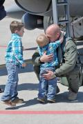 Maj. Tony Bradley greets two of his sons on the flight line of the 132nd Fighter Wing (132FW), Des Moines, Iowa, after returning home from deployment in Kandahar, Afghanistan.