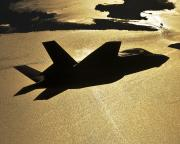 F-35B Silhouetted  Over Water