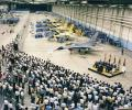 This photo shows the delivery ceremony of the first production F-16 in August 1978. After the prototype and FSD programs, the first Block 1 F-16 (serial  number 78-0001) was flown for the first time and  delivered to the Air Force that same month.